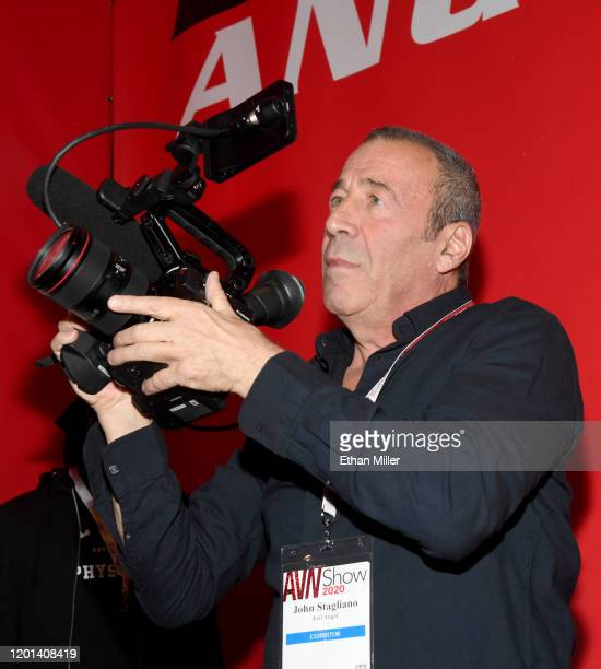 Adult film producer/director John Stagliano uses a video camera at the Evil Angel booth at the 2020 AVN Adult Entertainment Expo at the Hard Rock...