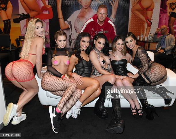 Adult film producer/director Jules Jordan poses behind adult film actresses Abella Danger, Jill Kassidy, Emily Willis, Kissa Sins, Athena Faris and...