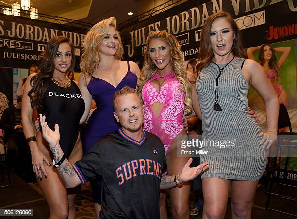 Adult film producer/director Jules Jordan poses in front of adult film actresses Abigail Mac, Alexis Texas, August Ames and Maddy O'Reilly at the...