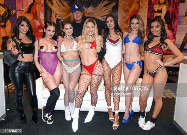 Adult film producer/director Jules Jordan stands behind adult film actresses Gina Valentina, Kissa Sins, Jill Kassidy, Abella Danger, Marley Brinx,...