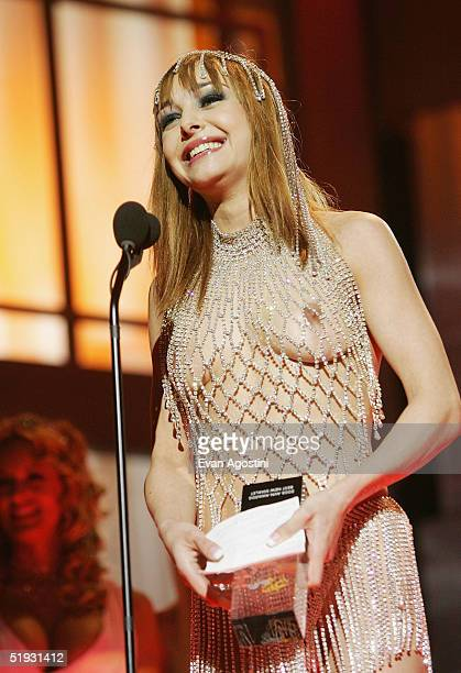 Adult film star Cytherea accepts an award for Best New Starlet during the 2005 AVN Awards on January 8, 2005 at the Venetian Hotel in Las Vegas,...