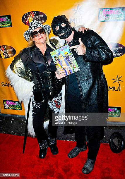 Adult film star Ginger Lynn and publisher Robert Rhine attend Halloween Hotness Costume Party held at Couture on October 25, 2014 in Hollywood,...