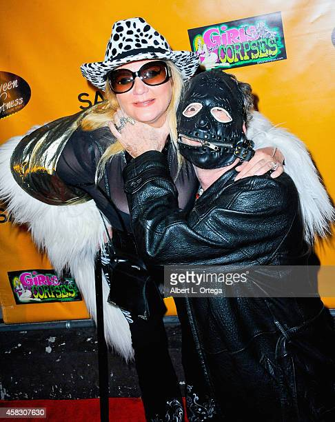 Adult film star Ginger Lynn and publisher Robert Rhine attend Halloween Hotness Costume Party held at Couture on October 25 2014 in Hollywood...