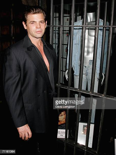 "Adult film star Jeff Stryker poses in front of his display at the unveiling of the new exhibit ""Idols of Gay Hollywood"" at The Hollywood Museum on..."