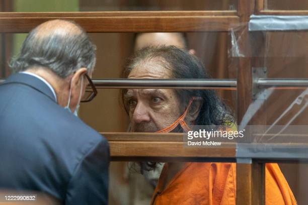 Adult film star Ron Jeremy talks with his attorney Stuart Goldfarb during arraignment on rape and sexual assault charges at Clara Shortridge Foltz...