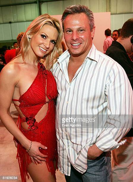 Adult film star Savanna Samson poses with Vivid Entertainment CoChairman Steven Hirsch at the 2005 AVN Adult Entertainment Expo at the Sands...