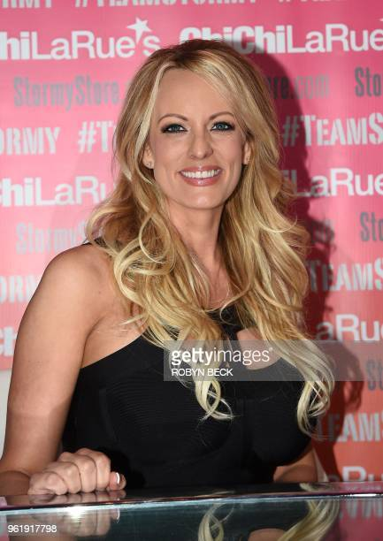 Adult film star Stormy Daniels poses and signs autographs at Chi Chi Larue's adult entertainment store May 23 2018 in West Hollywood California...