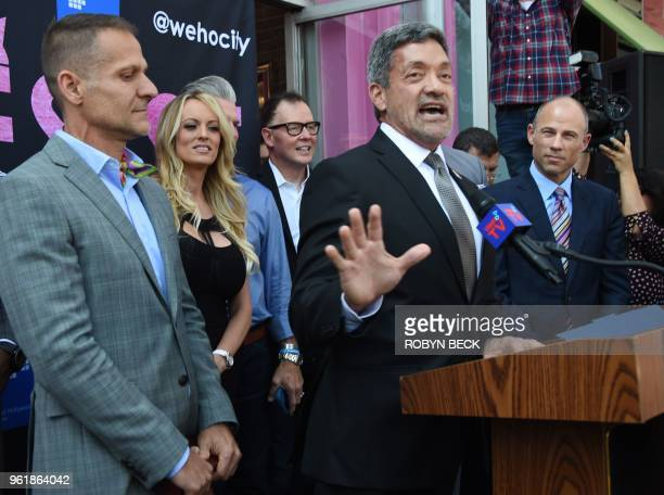 Adult film star Stormy Daniels receives a key to the city of West Hollywood from Mayor John Duran May 23 2018 in West Hollywood California At far...