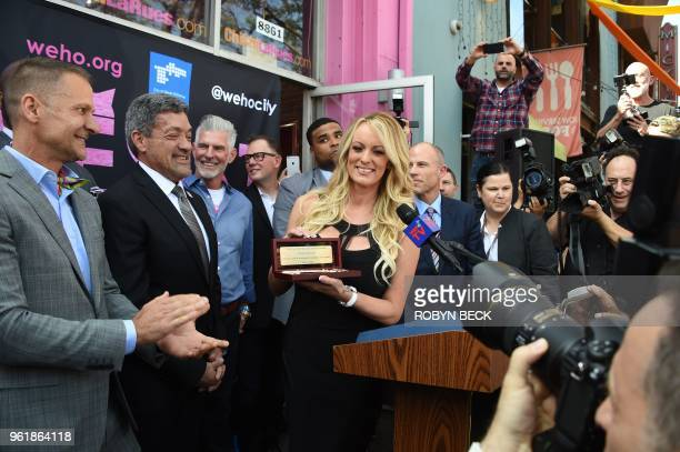 Adult film star Stormy Daniels receives a key to the city of West Hollywood from Mayor John Duran May 23 2018 in West Hollywood California Daniels...