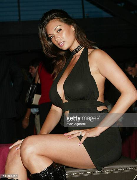Adult film star Tera Patrick poses at a book release party for her new book 'How To Make Love Like A Porn Star' at Avalon August 18 2004 in New York...
