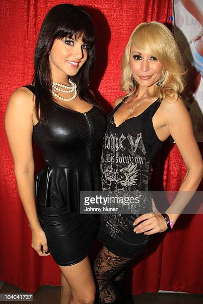 Adult film stars Sunny Leone and Monique Alexander attend the Adultcon Adult Entertainment Convention at Los Angeles Convention Center on September...
