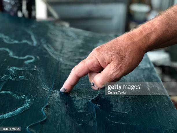 adult fingerpainting - finger painting stock pictures, royalty-free photos & images