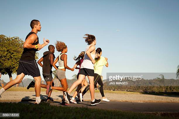 Adult friends doing training run in park