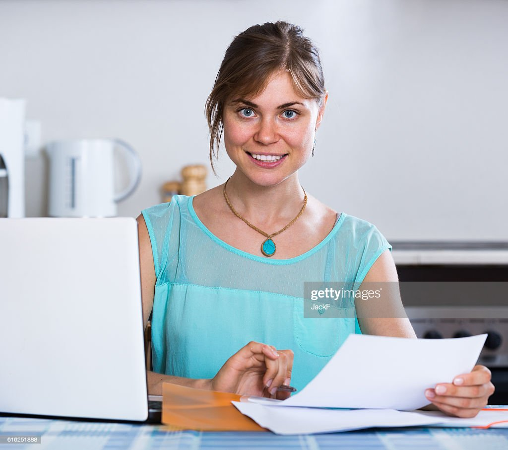 adult girl applying for bank loan at home : Stock Photo