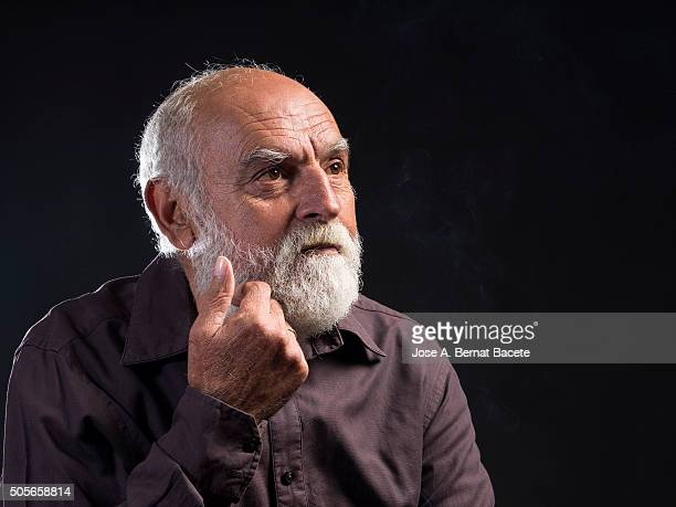 Adult hair and white beard thoughtfully and concern man.