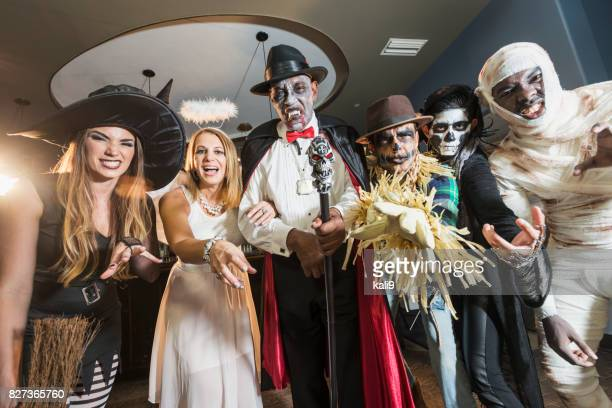 adult halloween party - happy halloween stock photos and pictures