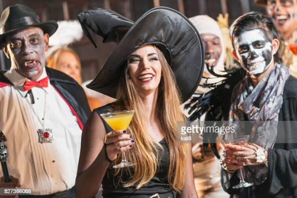 adult halloween party, witch drinking - happy halloween stock photos and pictures