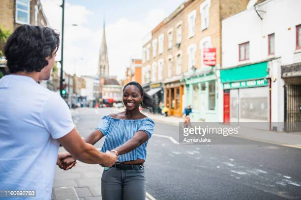 adult heterosexual couple enjoying stoke newington and twirling - things that go together stock pictures, royalty-free photos & images
