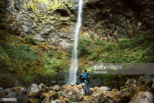 Adult Hikers Viewing Waterfall