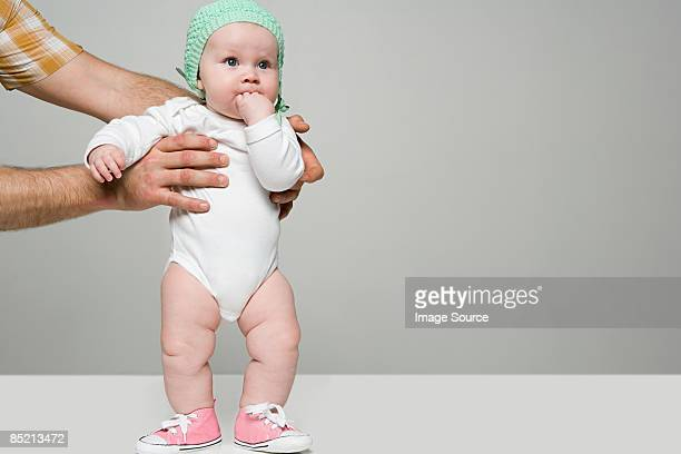 Adult holding baby