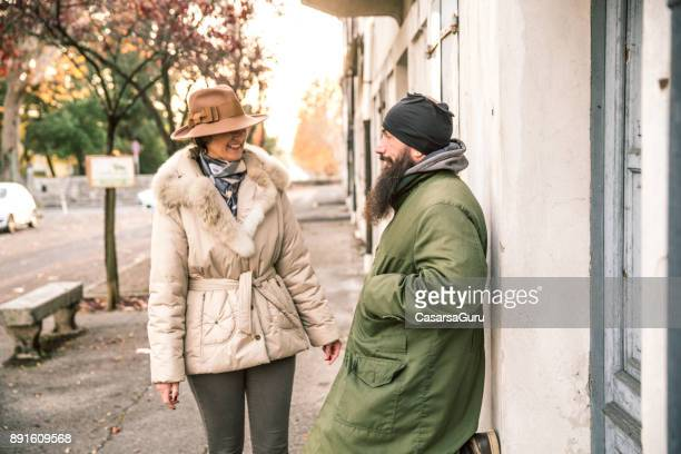 Adult Homeless Man and Mature Woman Interaction