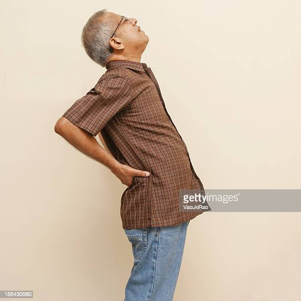 Adult Indian wincing from back pain