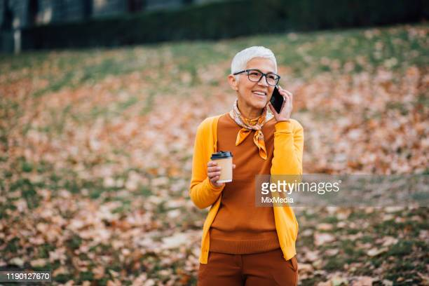 adult lady holding cup of coffee - women's issues stock pictures, royalty-free photos & images