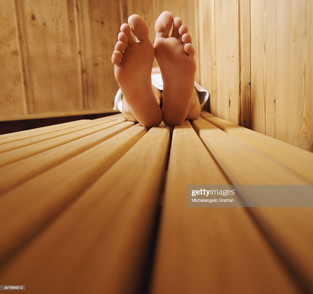 Adult Lying on a Bench in a Sauna : Stock Photo