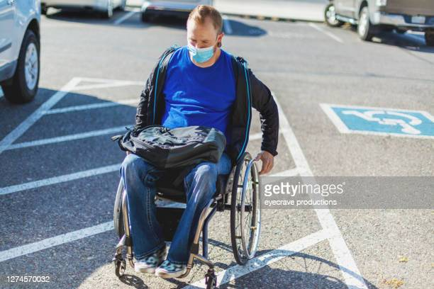 adult male college student in wheelchair on campus exiting disability equipped van - college admission stock pictures, royalty-free photos & images