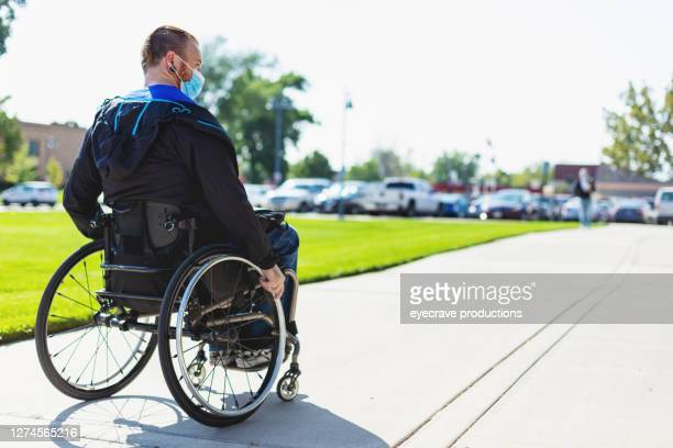 adult male college student in wheelchair on campus - college admission stock pictures, royalty-free photos & images
