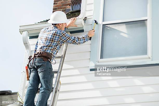 Adult male construction worker working on residence