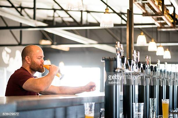 Adult Male Enjoying A Good Craft Beer At The Brewery