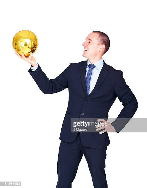 Adult male team manager looking at a golden football