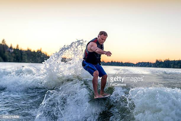 Adult male wake surfing