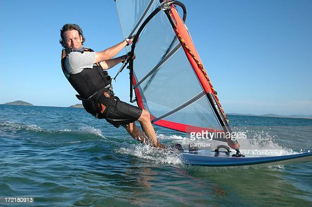 adult male windsurfing fun! - windsurfing stock pictures, royalty-free photos & images