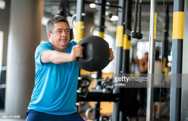 Adult man exercising at the gym