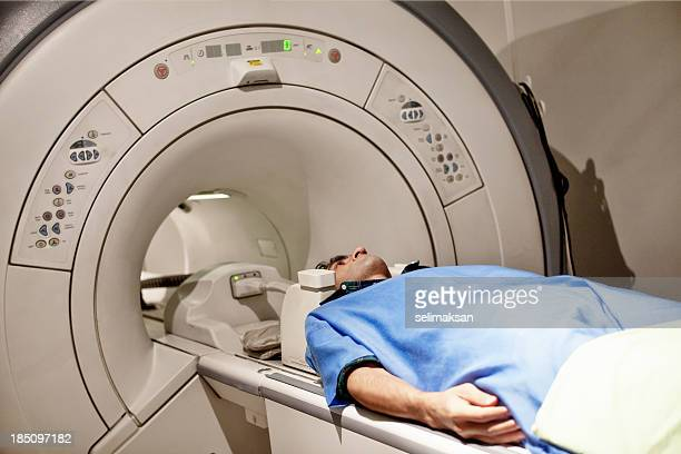 Adult Man In Protective Hospital Clothes Having MRI Scan