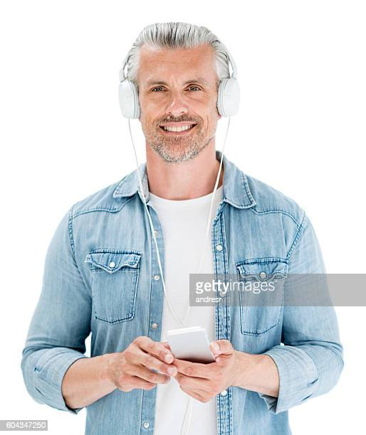 Adult man listening to music on his cell phone