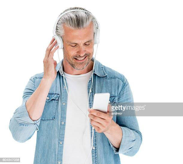 Adult man listening to music with headphones