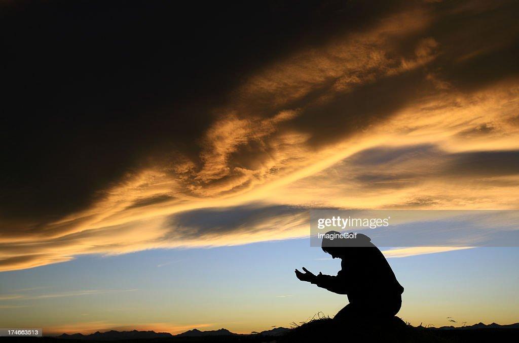 Adult Man Meditating at Sunset : Stock Photo