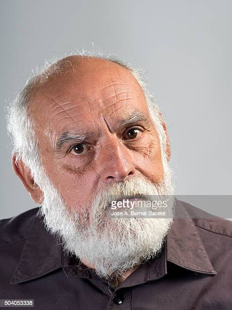Adult man of white beard, with gesture of anger