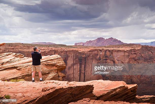 Adult Man Photographing the View of Horshoe Bend