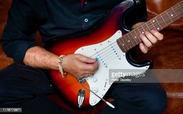 adult man playing electric guitar - musical symbol stock pictures, royalty-free photos & images