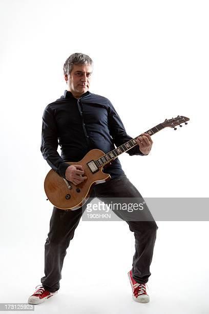 Adult man playing guitar