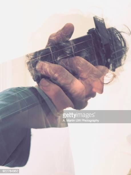 adult man playing guitar - martin guitar stock photos and pictures