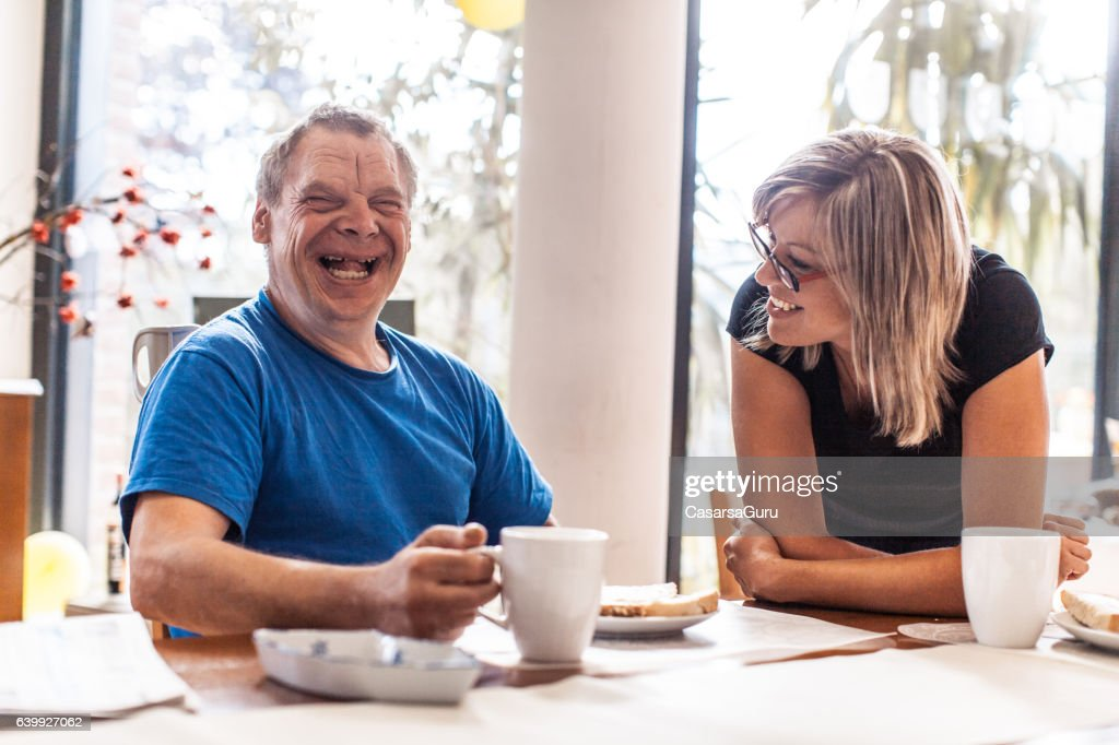 Adult Man Portrait with a Down Syndrome and a Caregiver : Stock Photo