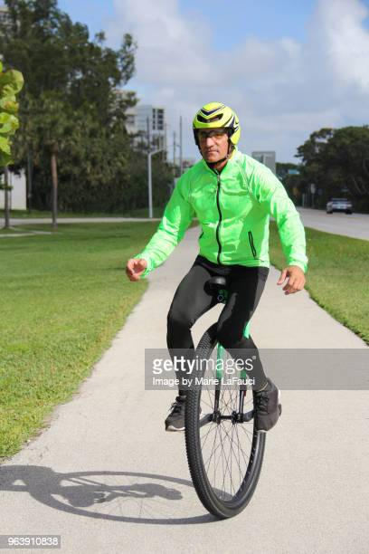 Adult man riding a unicycle