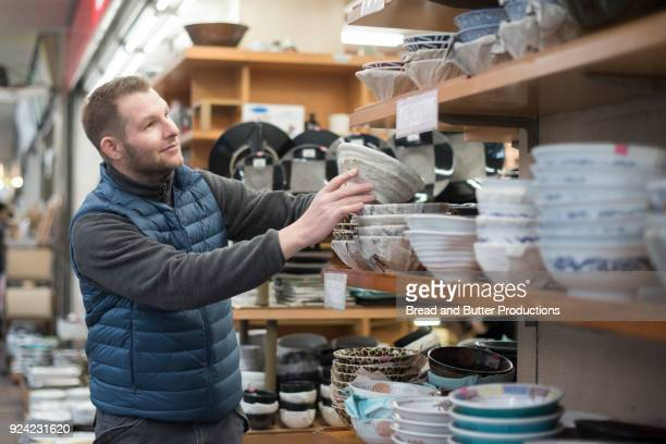 adult man shopping in kappabashi kitchen town in tokyo, japan - kitchenware shop stock pictures, royalty-free photos & images
