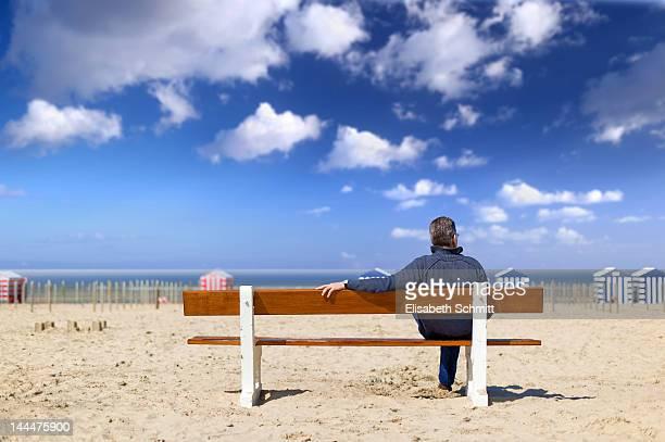 Adult man sitting on bench