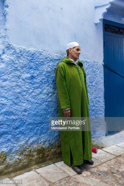 Adult man standing against the wall, Chefchaouen April 2018